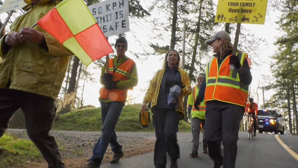 Two groups of demonstrators walked from each end of the road under police escort during heavy traffic. (CTV Vancouver Island)