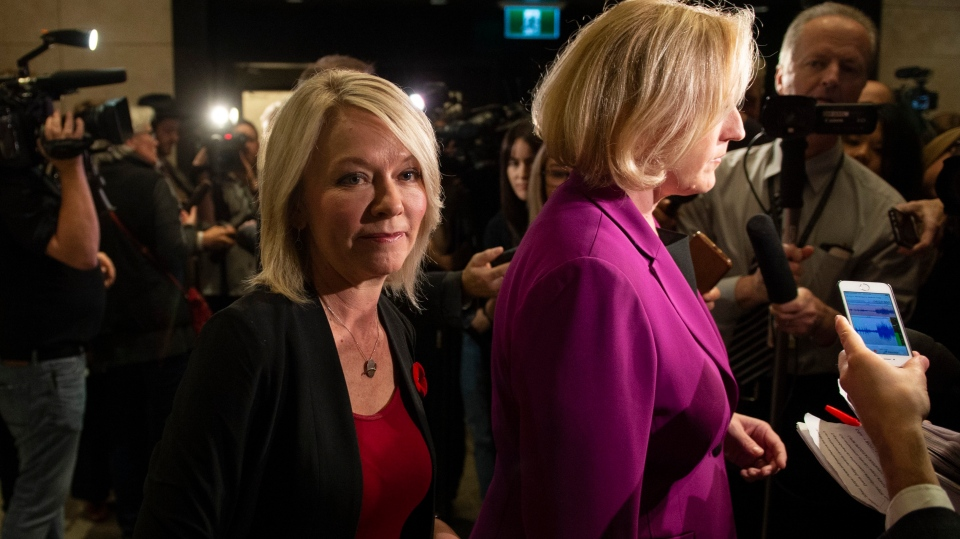 Conservative MP Candice Bergen, left, walks past former Conservative MP Lisa Raitt to attend a caucus meeting on Parliament Hill in Ottawa, on Wednesday, Nov. 6, 2019. THE CANADIAN PRESS/Justin Tang