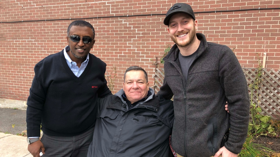 Chris MacMillan (center) got to thank his 'guardian angels' Mohammed Omer (left) and David Brousseau-Lambert (right) who helped him catch his much needed bus ride.