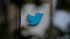 FILE - This July 9, 2019, file photo shows a sign outside of the Twitter office building in San Francisco. (AP Photo/Jeff Chiu, File)