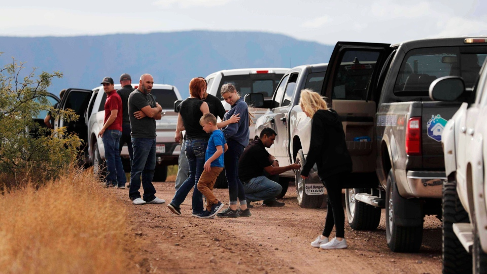 A caravan of friends and relatives of the LeBaron family arrive at the site where nine U.S. citizens, three women and six children related to the extended LeBaron family, were ambushed near Bavispe, at the Sonora-Chihuahua border, Mexico, Wednesday, Nov 6, 2019. (AP Photo/Marco Ugarte)
