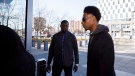 Dafonte Miller, right, arrives alongside family ahead of his testimony at the Durham Region Courthouse in Oshawa, Ont., on Wednesday, Nov. 6, 2019. THE CANADIAN PRESS/Cole Burston