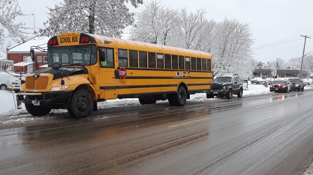 A school bus and an SUV after a crash