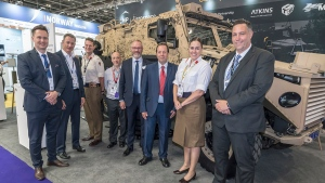 NP Aerospace CEO James Kempston, left, is shown with other company and British Army officials. (Handout/ NP Aerospace)