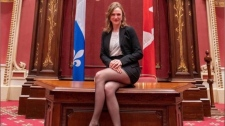 Quebec solidaire MNA Catherine Dorion posted to Facebook this photo of her sitting on the main desk of the Salon Rouge of the National Assembly.