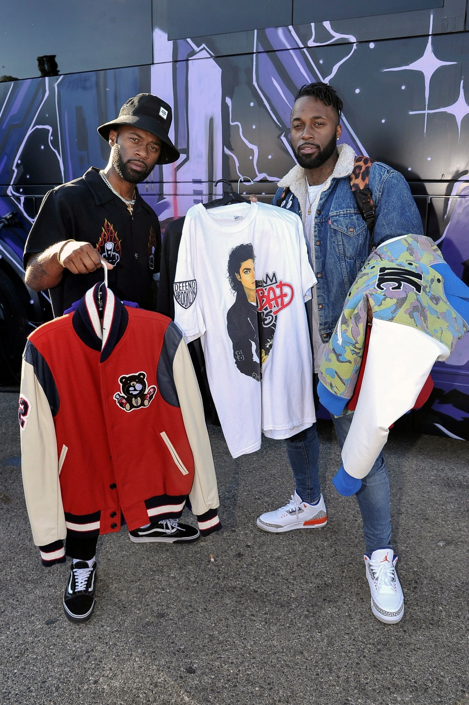 Darius Logan, left, and Dominique Logan of the musical duo 'Blaq Tuxedo' shop at Chris Brown's yard sale at Brown's home in the Tarzana neighborhood of the San Fernando Valley, Wednesday, Nov. 6, 2019, in Los Angeles. (Photo by Richard Shotwell/Invision/AP)