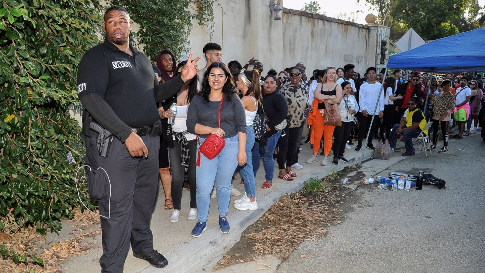 Chris Brown fans wait in line to attend Brown's yard sale at his home in the Tarzana neighborhood of the San Fernando Valley on Wednesday, Nov. 6, 2019, in Los Angeles. (Photo by Richard Shotwell/Invision/AP)