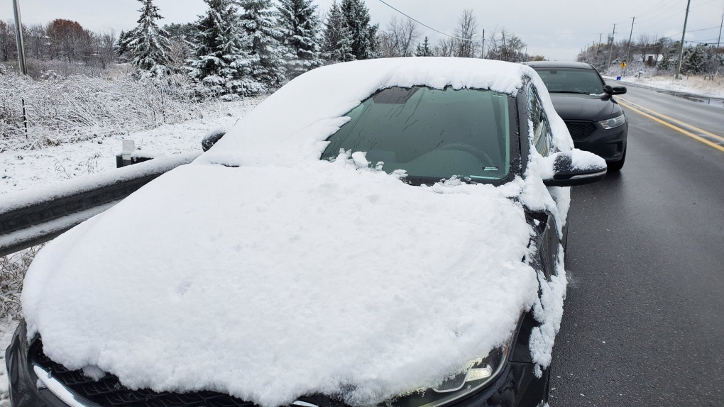 Snow covered car and driver fined