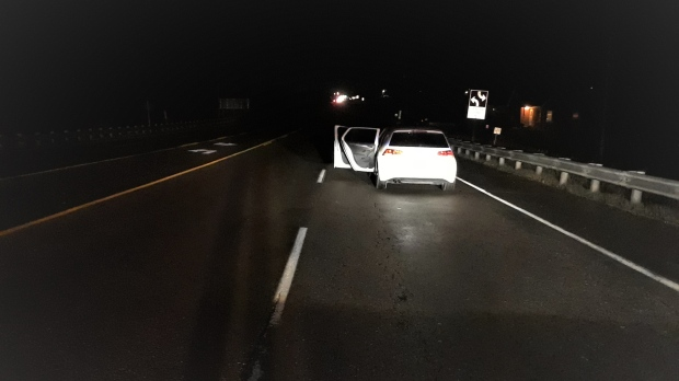 Car parked in a live lane of Highway 10, Caledon