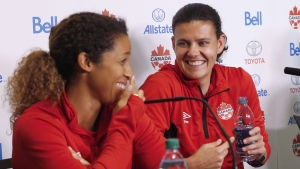 Team Canada soccer players Desiree Scott and Christine Sinclair joke around during a press conference in Winnipeg, Tuesday, June 6, 2017 prior to their match against Costa Rica. THE CANADIAN PRESS/John Woods
