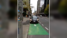 In response to a car blocking a Laurier bike lane, Ottawa cyclist Kevin O'Donnell stages a unique one man protest and posts the video on social media on Wednesday, Nov. 6, 2019. (@kevindotnet/Twitter )