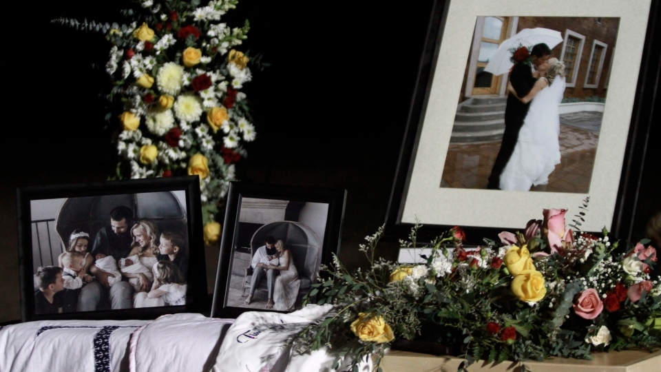 Family photos and flowers adorn the coffins that contain the remains of Rhonita Miller and her four children victims of a drug cartel ambush that left three women and six children dead, during their wake in La Mora, Mexico, Thursday, Nov. 7, 2019. (AP Photo/Christian Chavez)