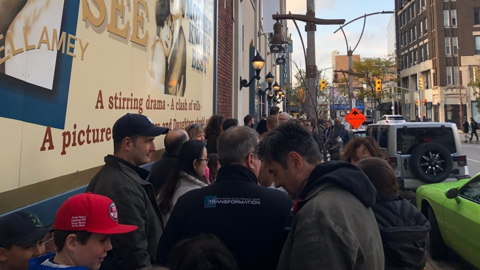 "Moviegoers lineup around the Capitol Theatre before the screening of ""Boys vs Girls"" at WIFF in Windsor on Saturday, Nov. 2, 2019. (Melanie Borrelli / CTV Windsor)"