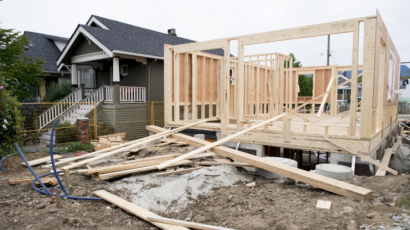 A new home is pictured being built in Vancouver, B.C., on June, 12, 2018. (Jonathan Hayward / THE CANADIAN PRESS)