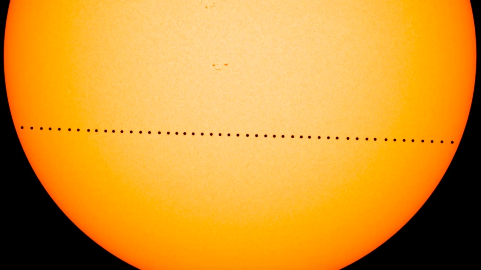 In this composite image provided by NASA, the planet Mercury passes directly between the sun and Earth on May 9, 2016 in a transit which lasted seven-and-a-half-hours. (NASA's Goddard Space Flight Center/SDO/Genna Duberstein via AP)