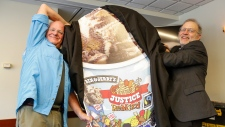 Ben Cohen and Jerry Greenfield, co-founders of Ben & Jerry's ice cream, unveil their newest flavor, Justice ReMix'd on Tuesday, Sept. 3, 2019 in Washington. (Eric Kayne/ AP Images for Ben & Jerry's)
