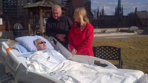 An ICU patient at St. Joseph's Healthcare hospital in Hamilton enjoys the sunshine outside thanks to the Three Wishes Project. (Three Wishes Project)