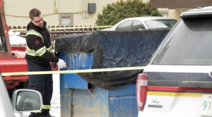 Saskatoon police were seen blocking off a dumpster in the 400 block of 5th Avenue North on Nov. 8 2019.