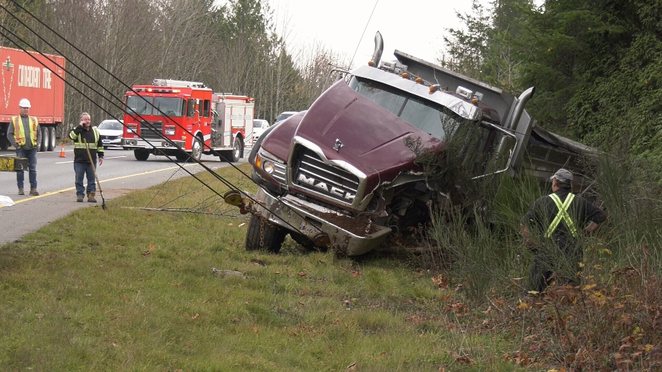 The truck was loaded with asphalt at the time, making it difficult for crews to remove it without the truck tipping over. (CTV Vancouver Island)