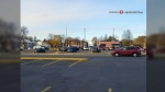 Caught on Cam: Police chase through busy parking