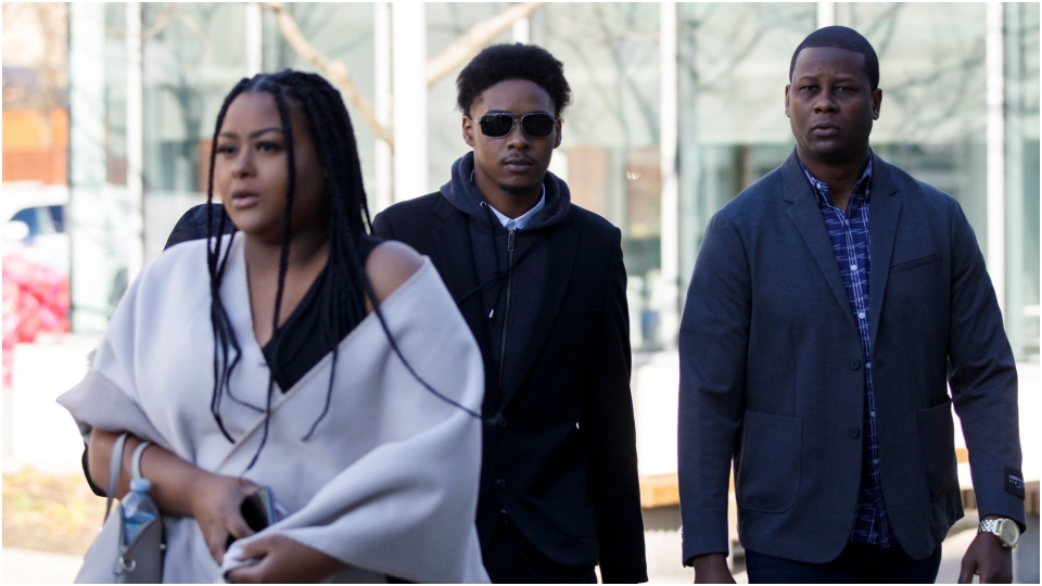 Dafonte Miller, middle, arrives alongside family ahead of his testimony at the Durham Region Courthouse in Oshawa, Ont., Wednesday, Nov. 6, 2019. (The Canadian Press/Cole Burston)