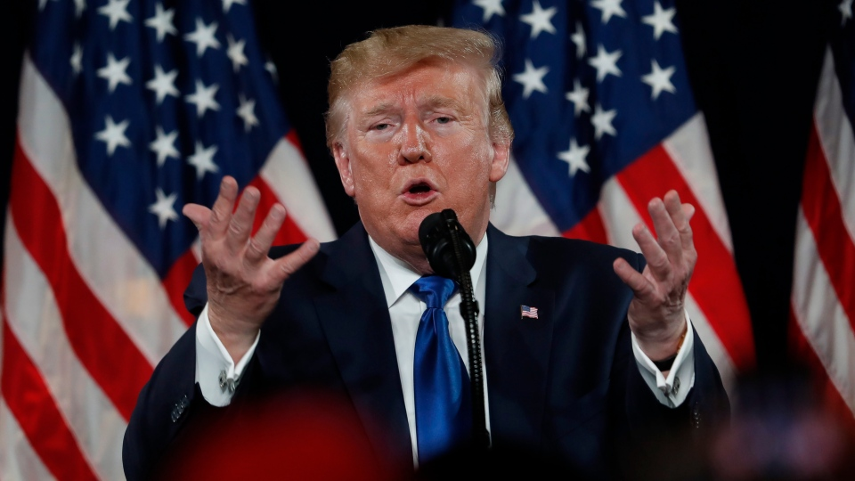 U.S. President Donald Trump gestures as he speaks at his Black Voices for Trump rally Friday, Nov. 8, 2019, in Atlanta. (AP Photo/John Bazemore)