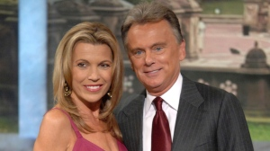 Vanna White and host Pat Sajak are pictured at Radio City Music Hall in this Sept. 29, 2007 file photo. (AP Photo/Peter Kramer, file)