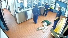 Corey Rogers lies on the floor under police custody at the Halifax police station, wearing a spit hood at about 11 p.m. on June 15, 2016 in this still image taken from surveillance video provided by Nova Scotia Courts. (THE CANADIAN PRESS/HO, Province of Nova Scotia Courts)