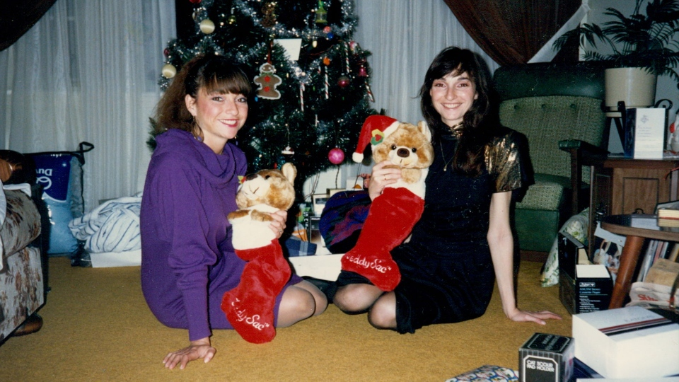 Dorothy Prowse (left) and her twin sister, Joan, celebrate Christmas together in this undated file photo.