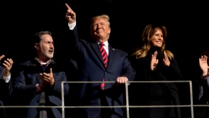 U.S. President Donald Trump and first lady Melania Trump are recognized during a NCAA college football game between LSU and Alabama at Bryant-Denny Stadium, in Tuscaloosa, Ala., Saturday, Nov. 9, 2019. (AP Photo/Andrew Harnik)