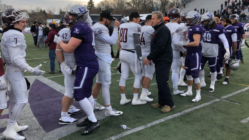 Western Mustangs head coach Greg Marshall and players congratulate members of the McMaster Marauders in their Yates Cup victory on Nov. 9, 2019. (@WesternU/Twitter)