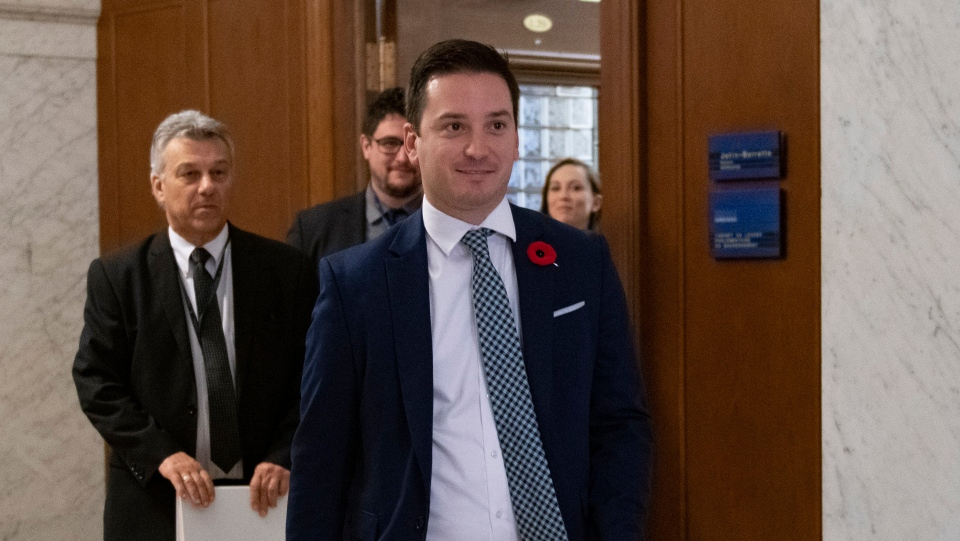 Simon Jolin-Barrette Minister of Immigration, Diversity and Inclusiveness arrives to unveil new measures, including a test for immigrants, Wednesday, October 30, 2019 at the legislature in Quebec City. . THE CANADIAN PRESS/Jacques Boissinot