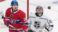 Montreal Canadiens' Phillip Danault (24) moves in on Los Angeles Kings goaltender Jonathan Quick during first period NHL hockey action in Montreal, Saturday, November 9, 2019.THE CANADIAN PRESS/Graham Hughes