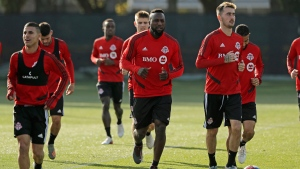 Toronto FC forward Jozy Altidore, center, jogs with teammates at the start of a training session, Friday, Nov. 8, 2019, in Tukwila, Wash. (AP Photo/Ted S. Warren)