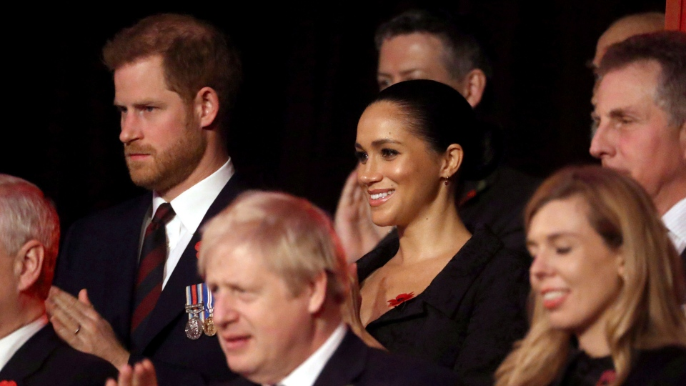 Prince Harry, background left and Meghan, the Duchess of Sussex attend the annual Royal British Legion Festival of Remembrance, at the Royal Albert Hall in Kensington, London, Saturday, Nov. 9, 2019. (Chris Jackson/Pool Photo via AP)