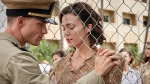 """This image released by Lionsgate shows Ed Skrein, left, and Mandy Moore in a scene from """"Midway."""" (Reiner Bajo/Lionsgate via AP)"""