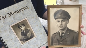 Karen Hunter holds her father's book about his time during the Second World War.