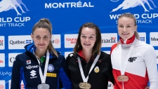 Gold medalist, Canada's Kim Boutin is flanked by silver medalist, Martina Valcepina, of Italy, and bronze medalist Natalia Maliszewska, of Poland, in the women's 500 metre final at the ISU World Cup Short Track competition in Montreal on Sunday, November 10, 2019. THE CANADIAN PRESS/Paul Chiasson