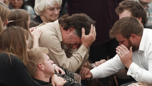 David Langford is consoled during the funeral service for his wife Dawna Ray and their two sons, in La Mora, Mexico, Thursday, Nov. 7, 2019. (AP Photo/Christian Chavez)