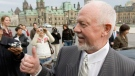 Hockey commentator Don Cherry gives a thumbs-up after talking with reporters outside the Parliament buildings in Ottawa Tuesday Nov. 7, 2006.(CP PHOTO/Tom Hanson) Canada