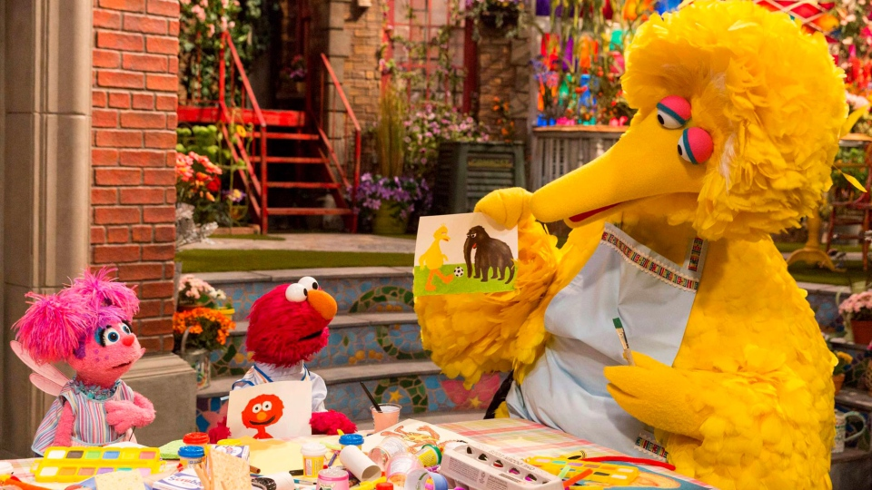 This image released by HBO shows characters, from left, Abby Cadabby, Elmo and Big Bird in a scene from