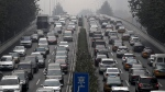 Heavy traffic on a city ring road in Beijing, on Oct. 26, 2017. (AP / Andy Wong)