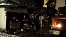 Charred vehicles in the attached garage of a home on Citadel Heights N.W. following an early morning fire