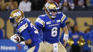 Winnipeg Blue Bombers quarterback Zach Collaros (8) hands off to Andrew Harris (33) during the first half of CFL action against the Calgary Stampeders in Winnipeg Friday, October 25, 2019. Quarterback Zach Collaros worked with Winnipeg's first-team offence Wednesday as the Blue Bombers prepared for Sunday's West Division semifinal at Calgary.THE CANADIAN PRESS/John Woods