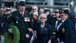Silver Cross Mother Anne Snyder is escorted by Col. John MacDonald, commander of the 36 Canadian Brigade Group, as she lays a wreath at Remembrance Day ceremonies at the Grand Parade in Halifax on Monday, Nov. 11, 2019. (THE CANADIAN PRESS/Andrew Vaughan)