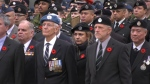 Veterans stand ahead of the singing of the national anthem at the Remembrance Day ceremony in downtown Vancouver on Monday. Nov. 11, 2019.