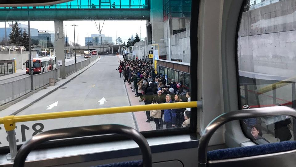 Crowded bus platforms at Blair Station
