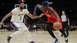 Toronto Raptors' Pascal Siakam, right, dribbles past Los Angeles Lakers' Anthony Davis (3) during the second half of an NBA basketball game Sunday, Nov. 10, 2019, in Los Angeles. (AP Photo/Marcio Jose Sanchez)