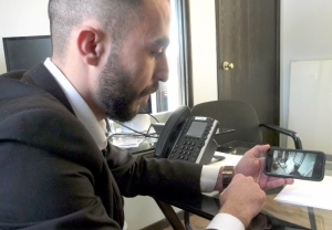 Country Auto Credit general manager Elmo Sayed looks at surveillance footage from a break-in at the dealership where thieves made off with a number of vehicles and sets or keys.