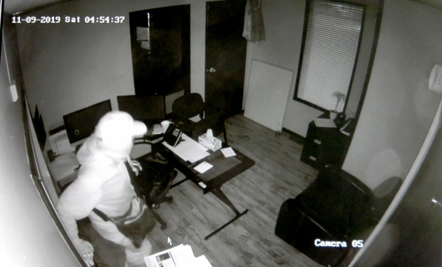 Surveillance footage shows someone breaking into the Country Auto Credit offices.